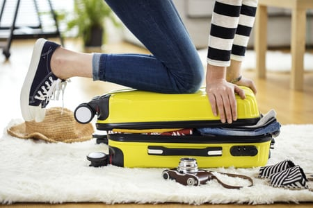 Woman Packing for A Vacation Overseas
