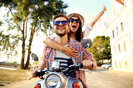 couple in love riding a motorbike abroad