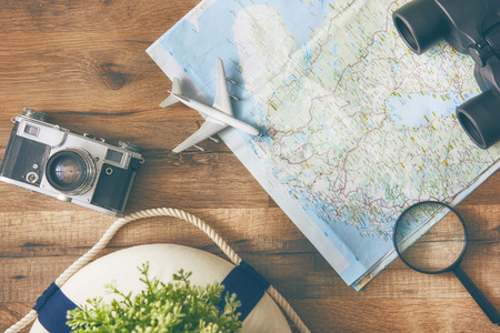 planning a trip concept with map and camera