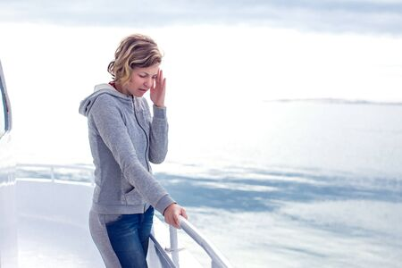 cruise sea motion sickness young tourist woman. seasick on boat vacation with headache. fear of travel or illness virus on cruising holiday